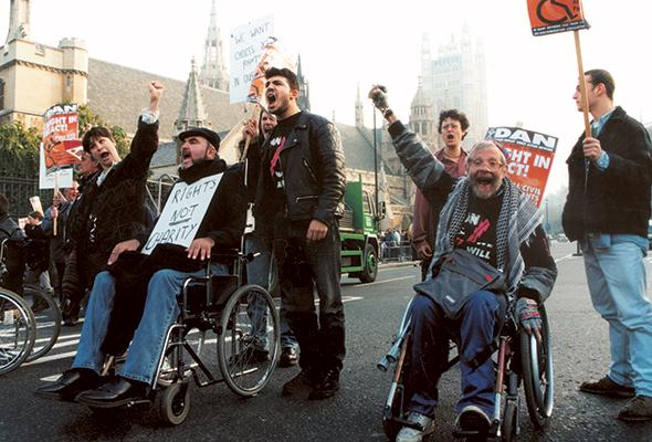 Members of DAN protesting on the streets of Westminster
