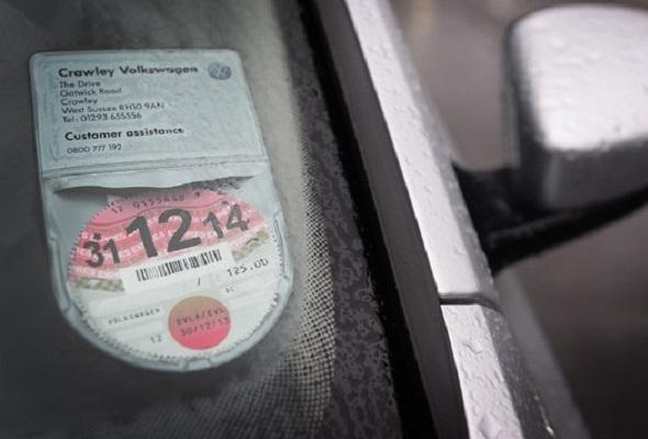 Two-tier parking as tax discs vanish